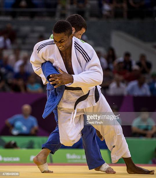 Loic Korval of France attacks and throws Amiran Papinashvili of Georgia for an ippon to secure the first win for the French Men's team who eventually...