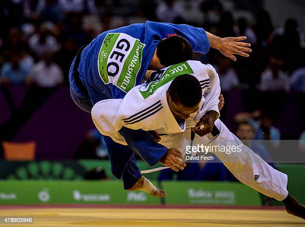 Loic Korval of France throws Amiran Papinashvili of Georgia for an ippon to secure the first win for the French Men's team who eventually won the...