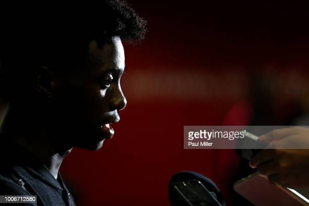 Loic Mbe Soh of Paris Saint Germain answers a question following the International Champions Cup match between Arsenal and Paris Saint Germain at the...