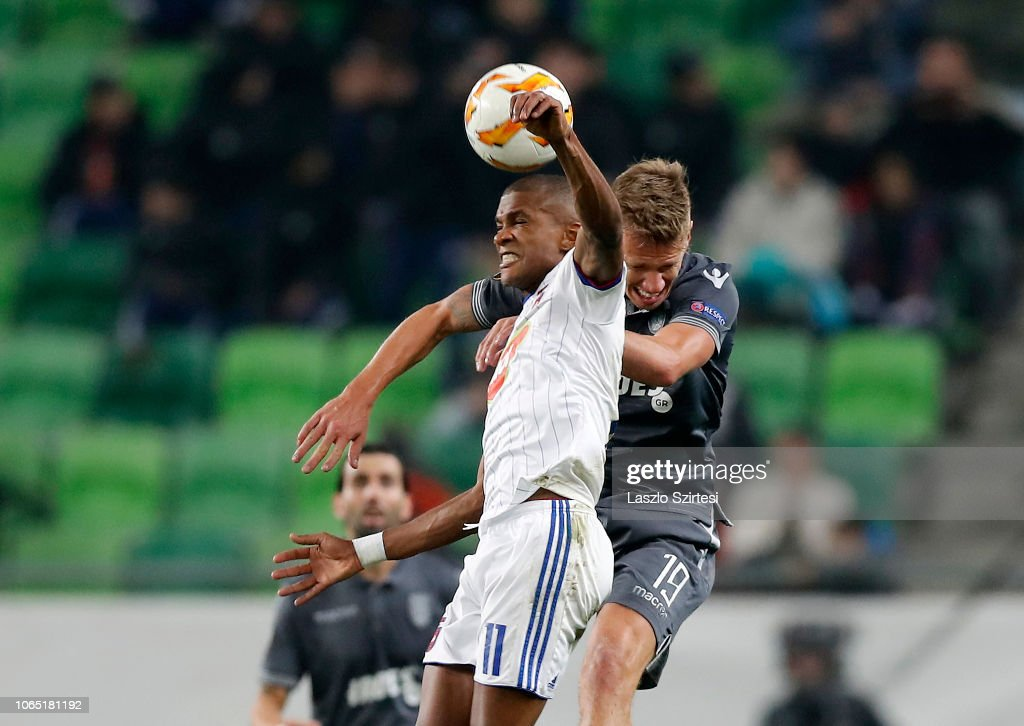 Loic Nego of Vidi FC battles for the ball in the air with ...