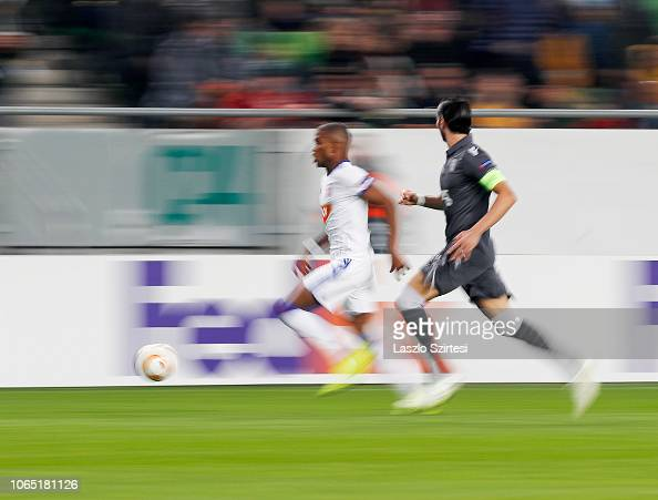 Loic Nego of Vidi FC competes for the ball with Jose ...