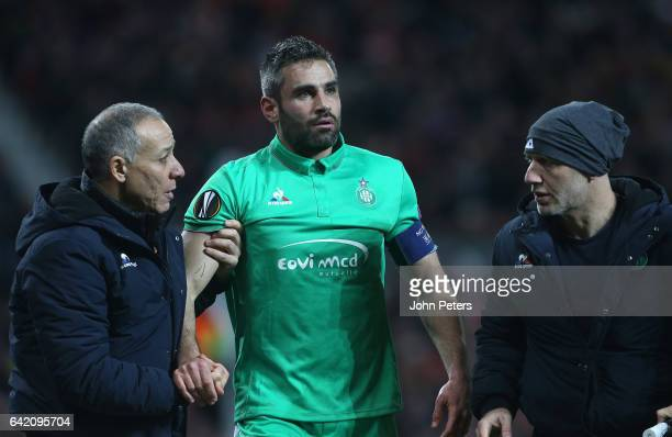 Loic Perrin of AS SaintEtienne receives treatment on a head injury after a clash with Chris Smalling of Manchester United during the UEFA Europa...