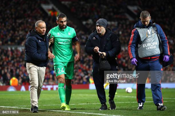 Loic Perrin of SaintEtienne leaves the pitch following an injury during the UEFA Europa League Round of 32 first leg match between Manchester United...