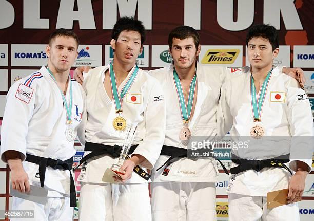 Loic Pietri of France Takanori Nagase of Japan Avtandili Tchrikishvili of Georgea and Takahiro Nakai of Japan stands on the podium at the men's 81kg...