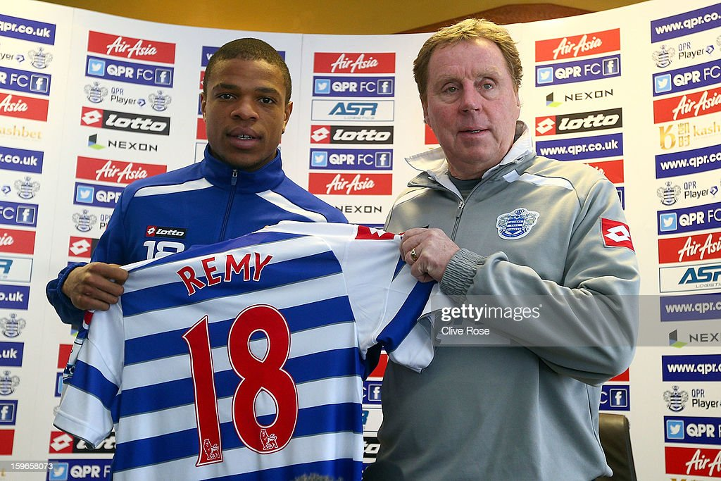 Loic Remy and Harry Redknapp of Queens Park Rangers pose together during a press conference on January 18, 2013 in Harlington, England.