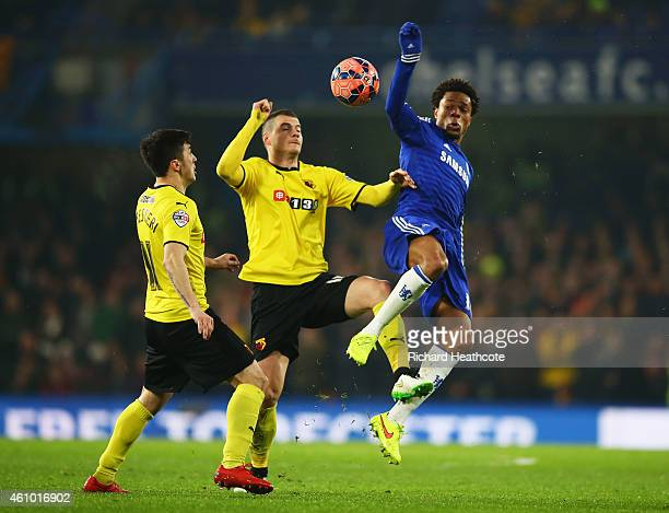 Loic Remy of Chelsea battles with Daniel Pudil and Fernando Forestieri of Watford during the FA Cup Third Round match between Chelsea and Watford at...