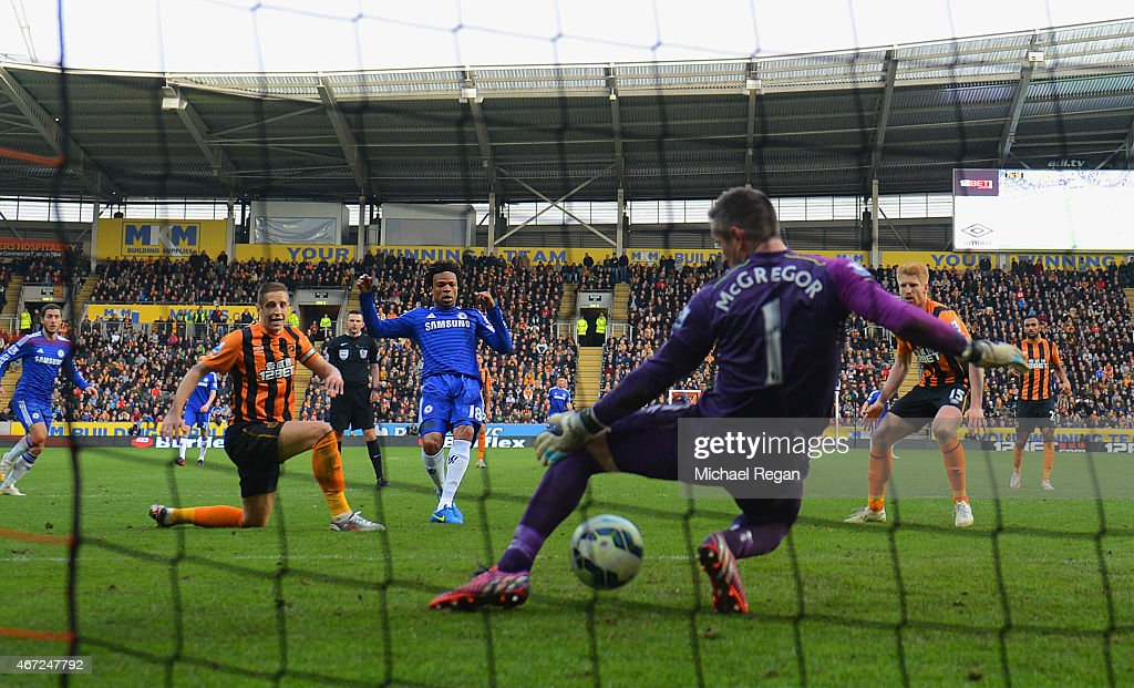 Loic Remy of Chelsea (C) beats goalkeeper Allan McGregor of Hull City (1) to score their third goal during the Barclays Premier League match between Hull City and Chelsea at KC Stadium on March 22, 2015 in Hull, England.