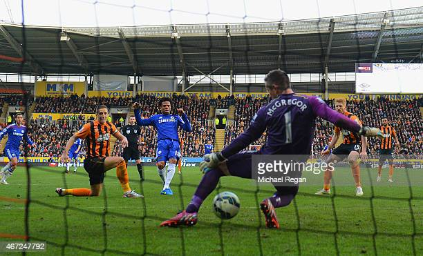 Loic Remy of Chelsea beats goalkeeper Allan McGregor of Hull City to score their third goal during the Barclays Premier League match between Hull...