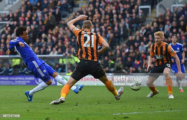 Loic Remy of Chelsea beats Michael Dawson of Hull City to score their third goal during the Barclays Premier League match between Hull City and...