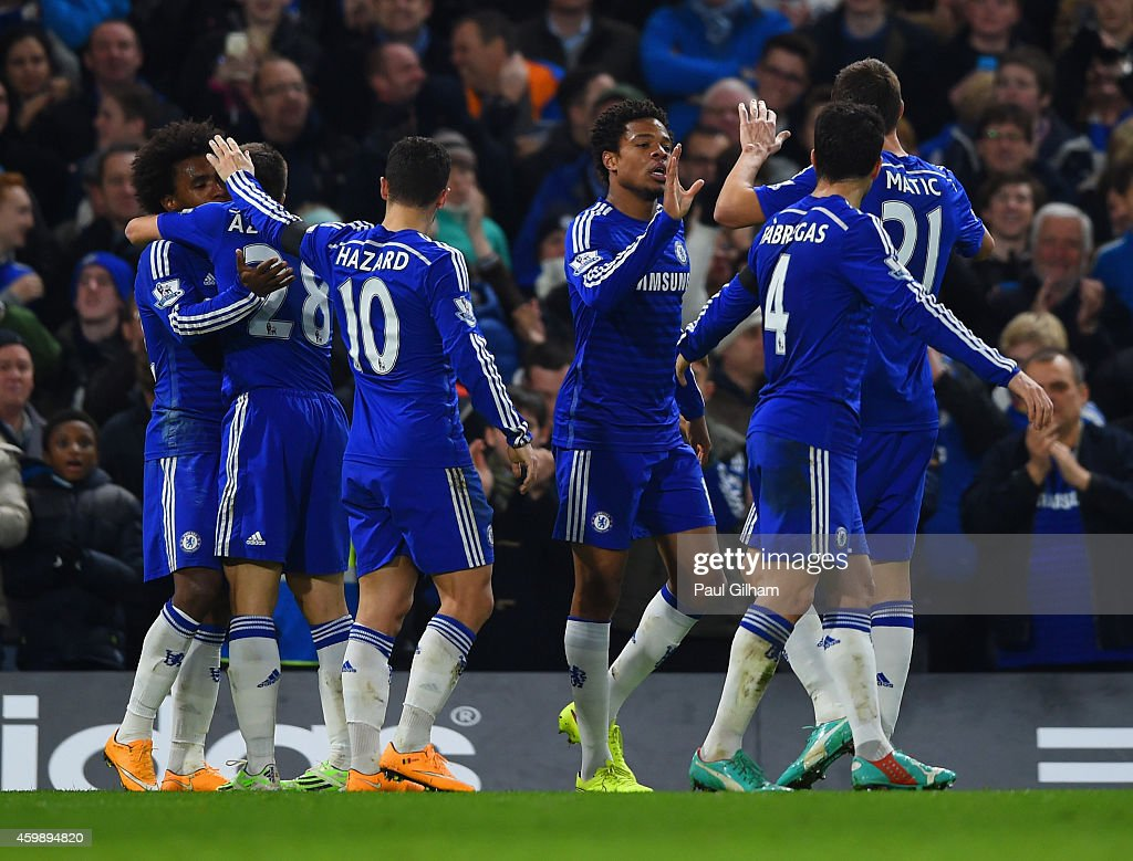 Loic Remy of Chelsea (C) celebrates scoring their third goal with Cesc Fabregas, Eden Hazard and Cesar Azpilicueta of Chelsea during the Barclays Premier League match between Chelsea and Tottenham Hotspur at Stamford Bridge on December 3, 2014 in London, England.