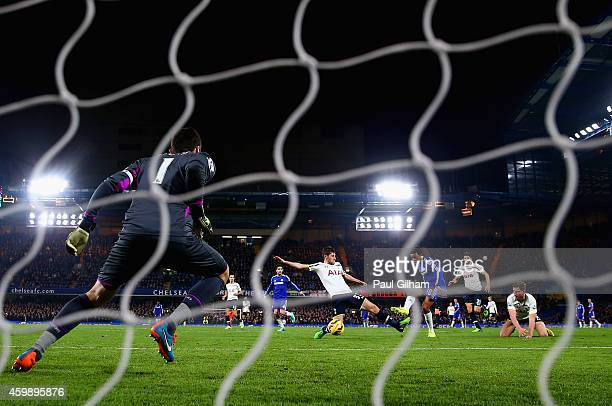 Loic Remy of Chelsea scores his teams third goal past Hugo Lloris of Spurs during the Barclays Premier League match between Chelsea and Tottenham...