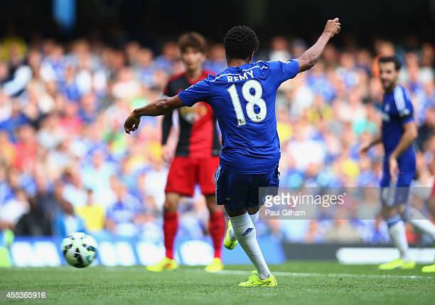 Loic Remy of Chelsea scores their fourth goal during the Barclays Premier League match between Chelsea and Swansea City at Stamford Bridge on...