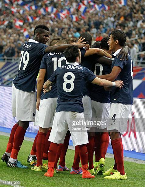 Loic Remy of France celebrate his goal with team matte during the International Friendly match between France and Spain at Stade de France on...