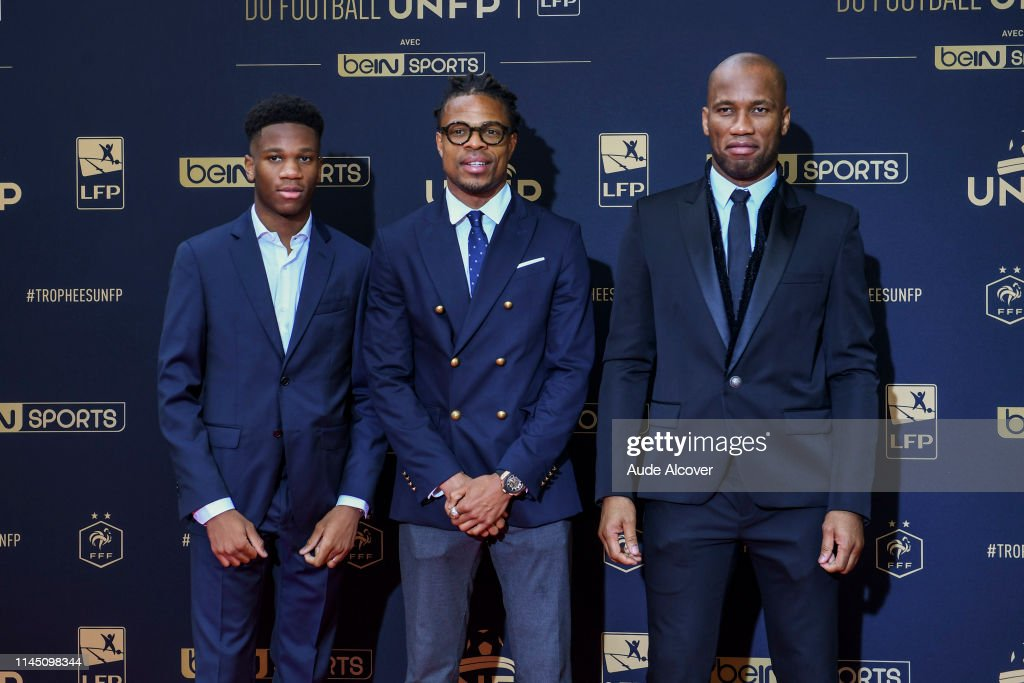 Loic Remy of Lille with Didier Drogba and his son during the