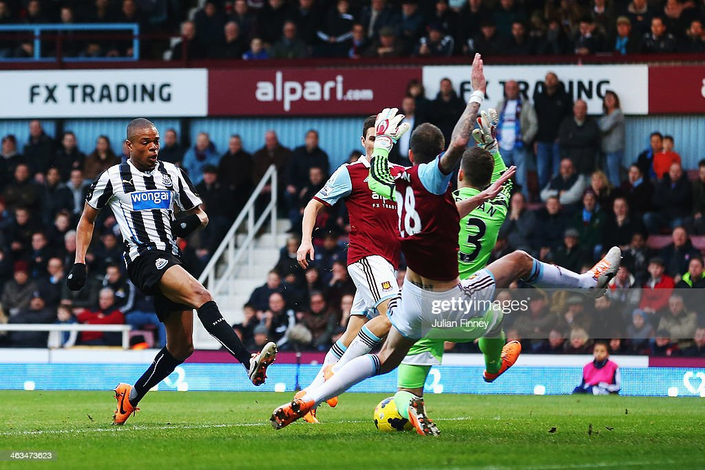 Loic Remy (L) of Newcastle United scores his teams second goal during the Barclays Premier League match between West Ham United and Newcastle United at the Boleyn Ground on January 18, 2014 in London, England.