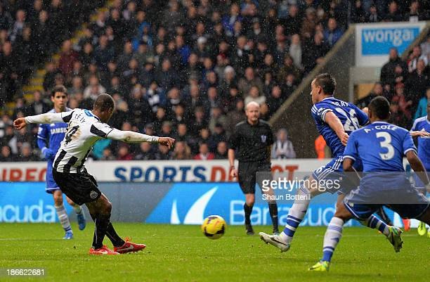 Loic Remy of Newcastle United scores their second goal during the Barclays Premier League match between Newcastle United and Chelsea at St James'...