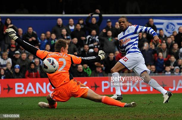 Loic Remy of Queens Park Rangers scores their first goal past Simon Mignolet of Sunderland during the Barclays Premier League match between Queens...