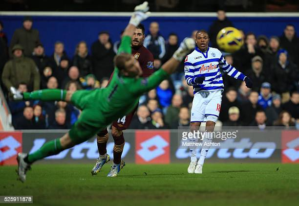 Loic Remy of Queens Park Rangers shoots wide past goalkeeper Joe Hart of Manchester City