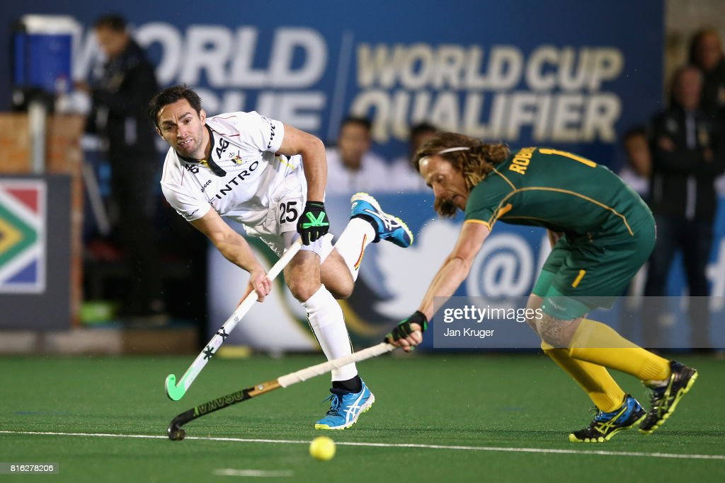 Loick Luypaert of Belgium shoots as Jonathan Robinson of South Africa attempts to block during the Group B match between South Africa and Belgium on day five of the FIH Hockey World League - Men's Semi Finals on July 17, 2017 in Johannesburg, South Africa.