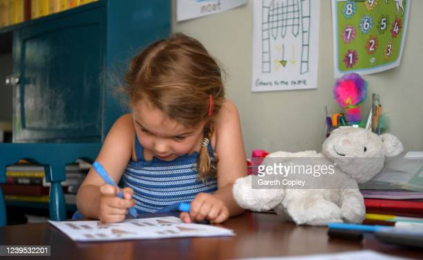 Lois CopleyJones aged 5 daughter of the photographer does school work with her mother at home after her parents decided to stay at home rather than...