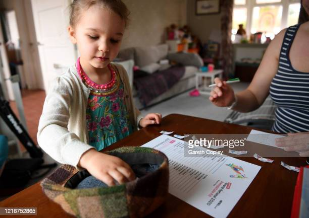 Lois CopleyJones aged 5 who is the photographer's daughter draws the horses for the family virtual Grand National sweepstake on April 04 2020 in...