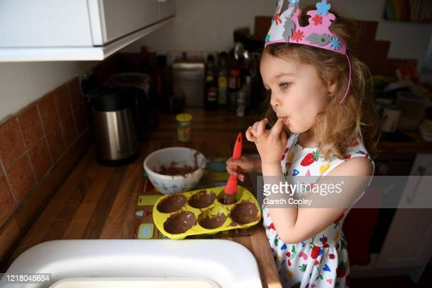 Lois Copley-Jones, aged 5, who is the photographer's daughter, makes chocolate Easter eggs at home on April 10, 2020 in Newcastle Under Lyme, United...