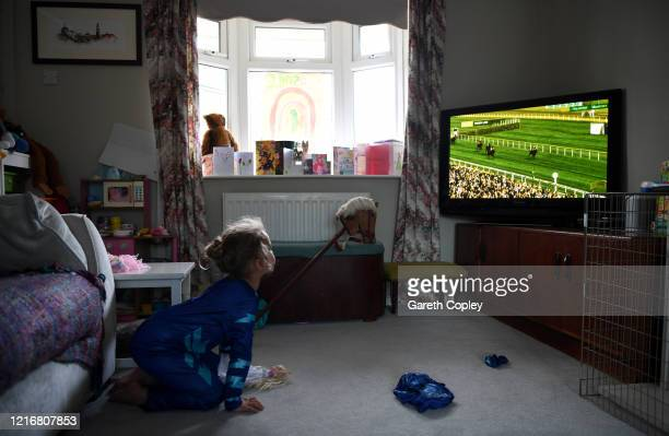 Lois CopleyJones aged 5 who is the photographer's daughter watches the virtual Grand National sweepstake on April 04 2020 in Newcastle Under Lyme...