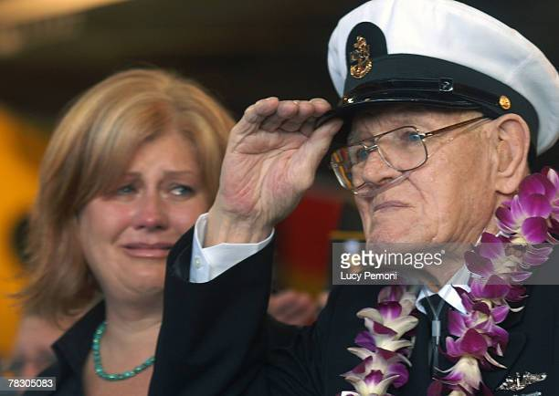 Lois Deininger of San Francisco watches her father Pearl Harbor survivor Edward Gaulrapp of Freeport Illinois salute during the commemoration marking...