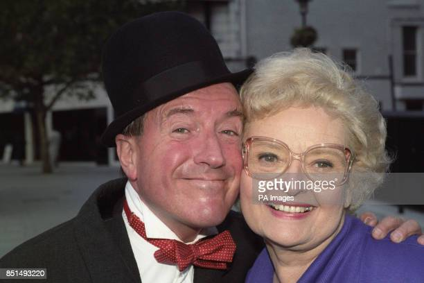 Lois Laurel daughter of comedian Stan Laurel poses with entertainer Roy Castle who is dressed as her famous father They were promoting the video...