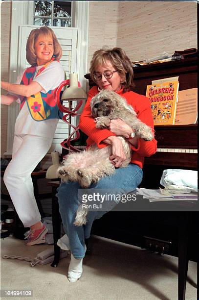Lois Lillienstein and her dog Rosie a 11mth old Dandie Dinmont Terrier at the piano rembering the past