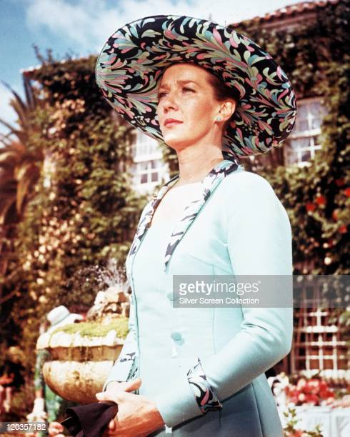 Lois Maxwell , Canadian actress, wearing a pale blue jacket and patterned wide-brimmed hat in a publicity still issued for the film, 'On Her...