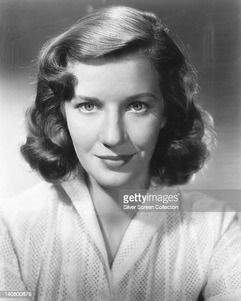 Lois Maxwell , Canadian actress, wearing a white blouse in a studio portrait, against a grey background, circa 1950.