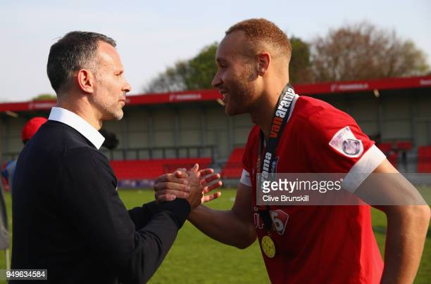 Lois Maynard of Salford City is congratulated by Ryan Giggs co owner of Salford City prior to the official group photo after Salford win the National...