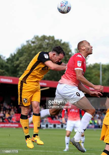 Lois Maynard of Salford City jumps for a header with during Luke Joyce of Port Vale during the Sky Bet League Two match between Salford City and Port...