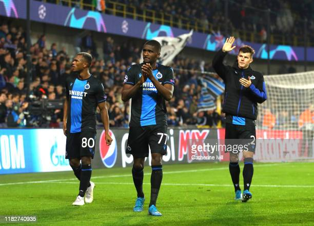 Lois Openda, Clinton Mata and Eduard Sobol of Club Brugge show appreciation to the fans after the UEFA Champions League group A match between Club...