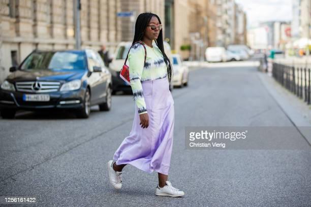Lois Opoku is seen wearing batik shirt Proenza Schouler, pink skirt Monki, Adidas sneaker, Lala Berlin bag, Ariane Ernst necklace on July 14, 2020 in...