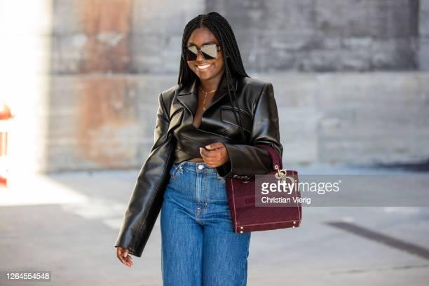 Lois Opoku is seen wearing cropped leather jacket blazer Aleksandre Akhaltkatsishvili jeans Levis Dior bag sunglasses Dior on August 07 2020 in...