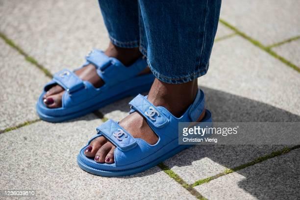 Lois Opoku is seen wearing Levis denim jeans, blue Chanel sandals on May 30, 2020 in Berlin, Germany.