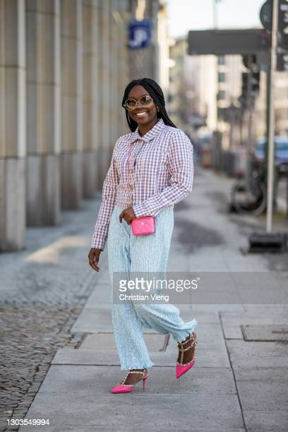 Lois Opoku is seen wearing pants and jacket Monki, Chanel micro bag in pink, Valentino heels on February 22, 2021 in Berlin, Germany.