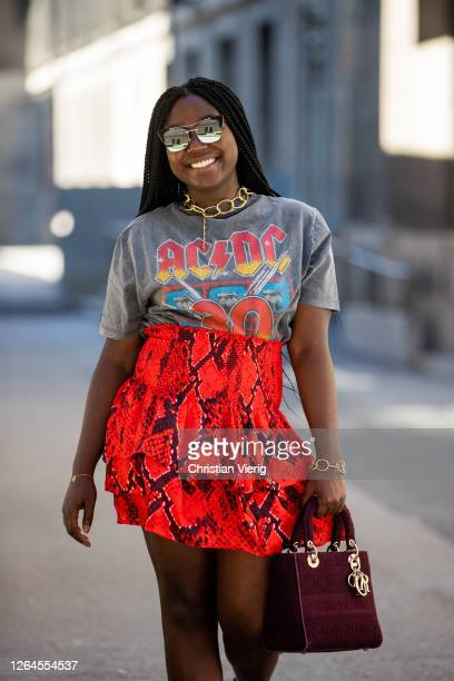 Lois Opoku is seen wearing red skirt Lala Berlin Dior bag Ariane Ernst necklace Pilgrim bracelet Pull and Bear tshirt white sunglasses Prive Revaux...