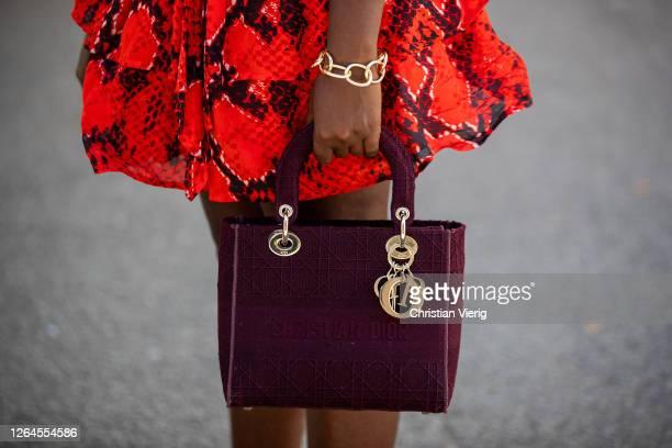 Lois Opoku is seen wearing red skirt Lala Berlin Dior bag Pilgrim bracelet on August 07 2020 in Berlin Germany