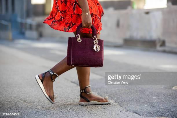 Lois Opoku is seen wearing red skirt Lala Berlin Dior bag Pilgrim bracelet sandals Isabel Marant August 07 2020 in Berlin Germany
