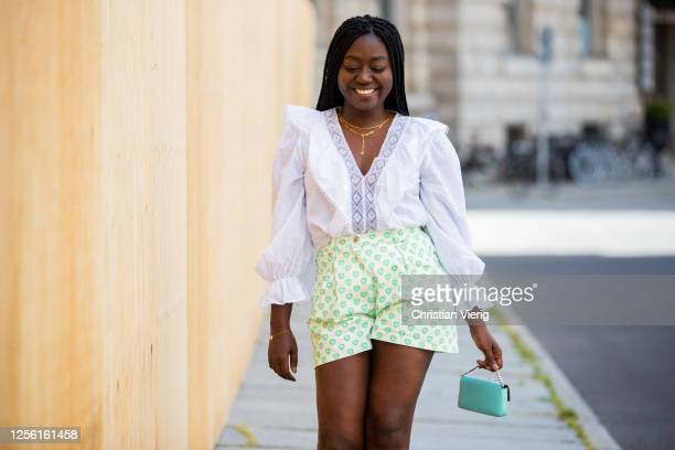 Lois Opoku is seen wearing white blouse Zara, shorts Miu Miu, Fendi mini bag, Ariane Ernst necklace, Proenza Schouler heels on July 14, 2020 in...
