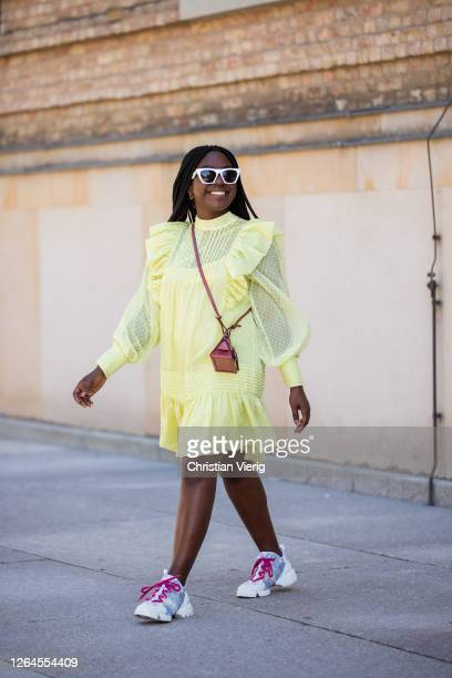 Lois Opoku is seen wearing yellow dress HM Boyy mini bag Dior sneaker Privé Revaux sunglasses in white on August 07 2020 in Berlin Germany