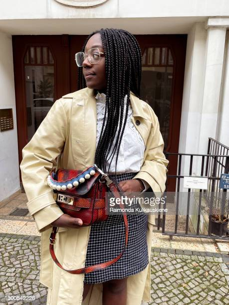 Lois Opoku wearing coat from Edited , blouse - Sezane, skirt from Gestuz, socks - Lacoste, shoes - Prada, glasses - Rayban and proenza schouler Bag...