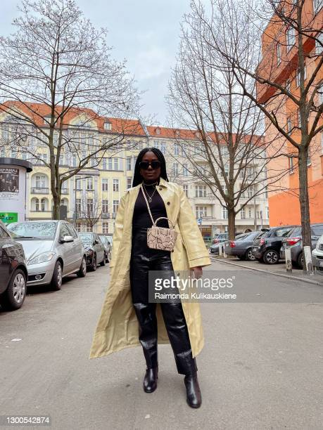 Lois Opoku wearing coat from Edited, turtleneck from Zara, pants - NAKD, shoes - ATP Atelier, bag - ATP Atelier and sunglasses from Burberry poses...