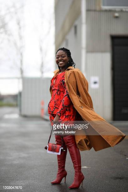 Lois Opoku wearing Lala Berlin dress and bag before LalaBerlin on January 30, 2020 in Copenhagen, Denmark.