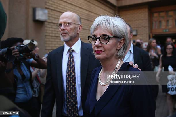 Lois Pistorius and Arnold Pistorius, the aunt and uncle of Oscar Pistorius, leave North Gauteng High Court during the lunch break as Judge Thokozile...