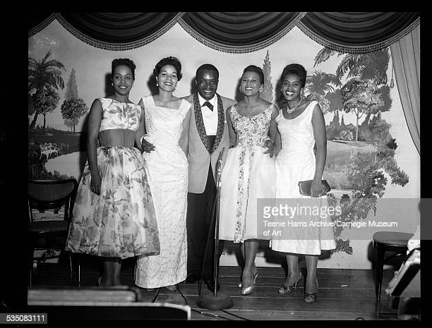 Lois Weaver Watson Frances Bell Nunn Walt Harper Mabel Bookert and Phyllis Pitts standing in front of landscape mural for FROGS formal Gateway Plaza...