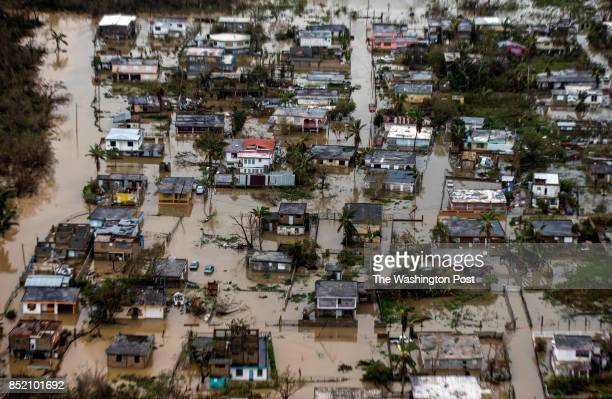 Aerial photo of the floadings in the costal town of Loiza in the north shore of Puerto RicoHurricane Maria passed through Puerto Rico leaving behind...